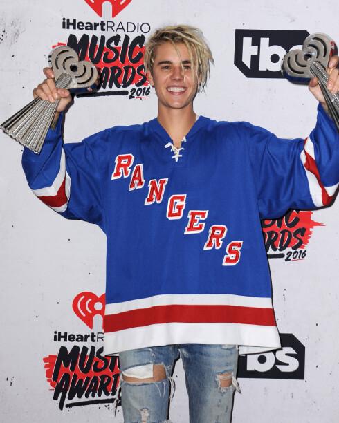 OPPGITT: Justin Bieber har flere ganger blitt frustrert over at musikken havner i skyggen på konsertene hans. På iHeartRadio Music Awards i april vant han flere priser.  Foto: Pa Photos