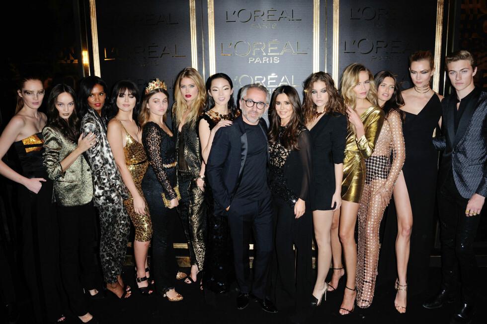 RYKTENE SVIRRER: Cheryl Cole dukket opp på fest med L'Oreal med en tydelig større mage.  Foto: Abaca