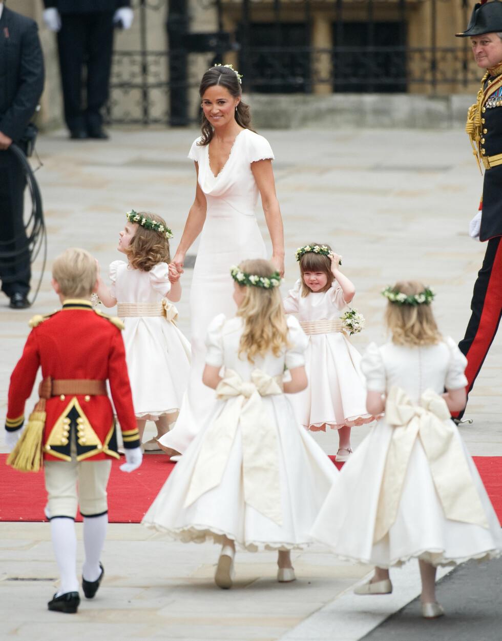 BLE BERØMT: Pippa Middleton fikk mye oppmerksomhet for sin hvite, sexy brudepikekjole i bryllupet til søsteren Kate og prins William i 2011. Neste år skal hun etter planen selv stå brud.   Foto: Pa Photos
