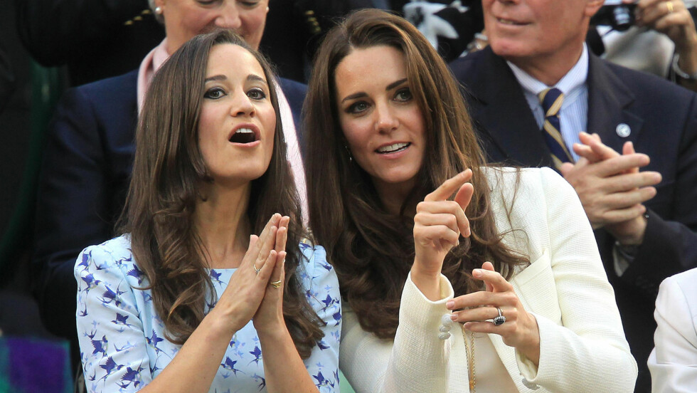 FRASTÅLET PRIVATE BILDER: Pippa Middleton (t.v), søsteren til hertuginne Kate av Cambridge, skal denne uken ha blitt utsatt for et alvorlig hackerangrep. Hackeren skal angivelig ha prøvd å selge over 3000 bilder av en svært personlig karakter til flere medier. Her er de berømte søstrene avbildet på Wimbledon i 2012.  Foto: Pa Photos