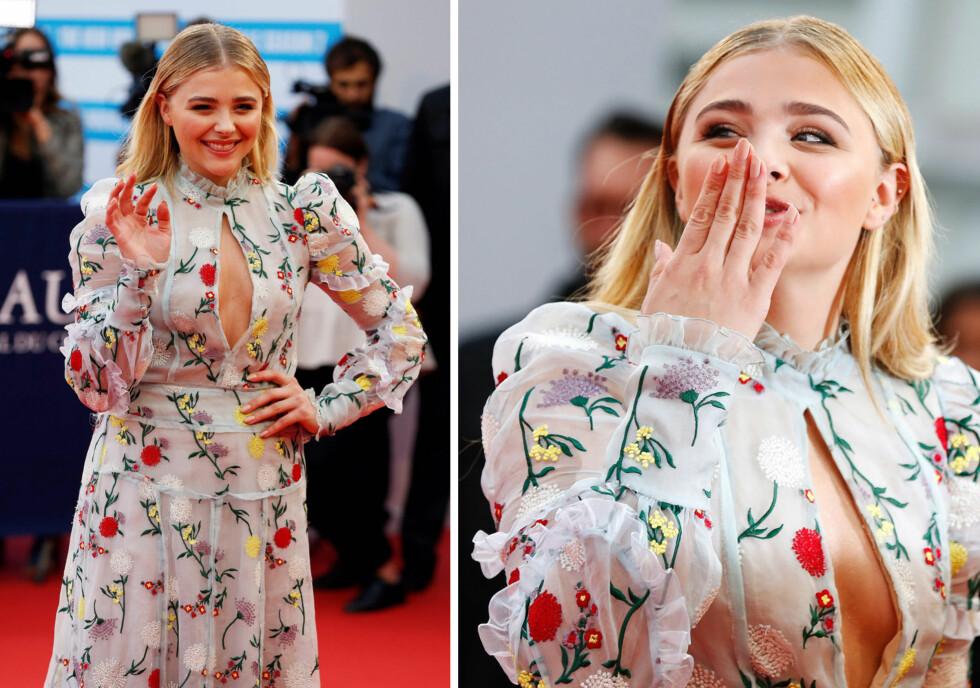 STRÅLTE: Chloe Grace Moretz tok seg flott ut i denne yndige, men samtidig sensuelle kjolen fra Erdem. 19-åringen lot seg tilsynelatende ikke affisere av bruddryktene som svirrer heftig rundt henne. Foto: NTB Scanpix