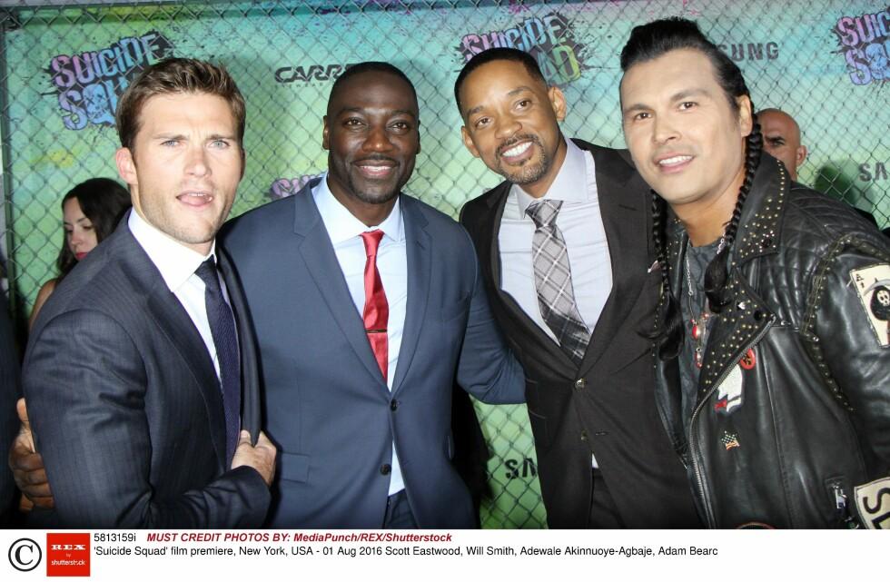 AKTUELL PÅ LERRETET: Scott Eastwood (t.v) spiller i filmen «Suicide Squad». Her sammen med motspillerne Adewale Akinnuoye-Agbaje, Will Smith og Adam Bearc på filmpremieren i New York i starten av august. Foto: Rex Features