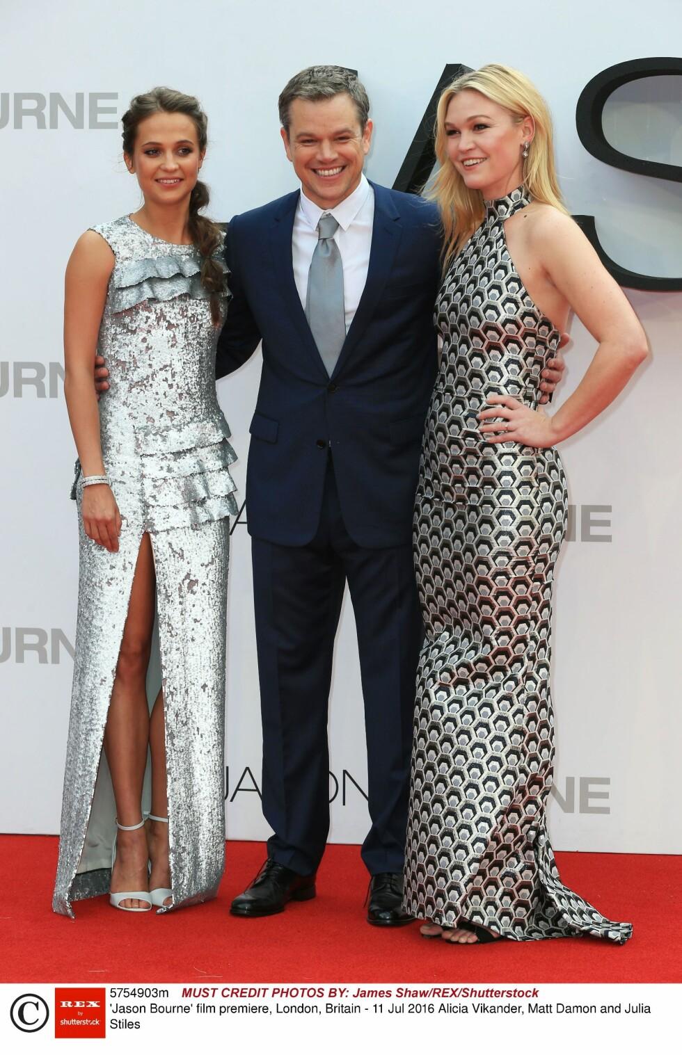 PÅ RØD LØPER: Damon er for tiden aktuell i den nyeste Jason Bourne-filmen. Her under London-premieren med kollegaene Alicia Vikander og Julia Stiles tidligere denne måneden.   Foto: Rex Features