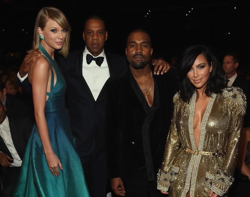 FRA VENNER TIL FIENDER: Taylor Swift sammen med Jay Z, Kanye West og Kim Kardashian under Grammy-utdelingen i 2015. Nå er ikke stemningen like hjertelig. Foto: Afp