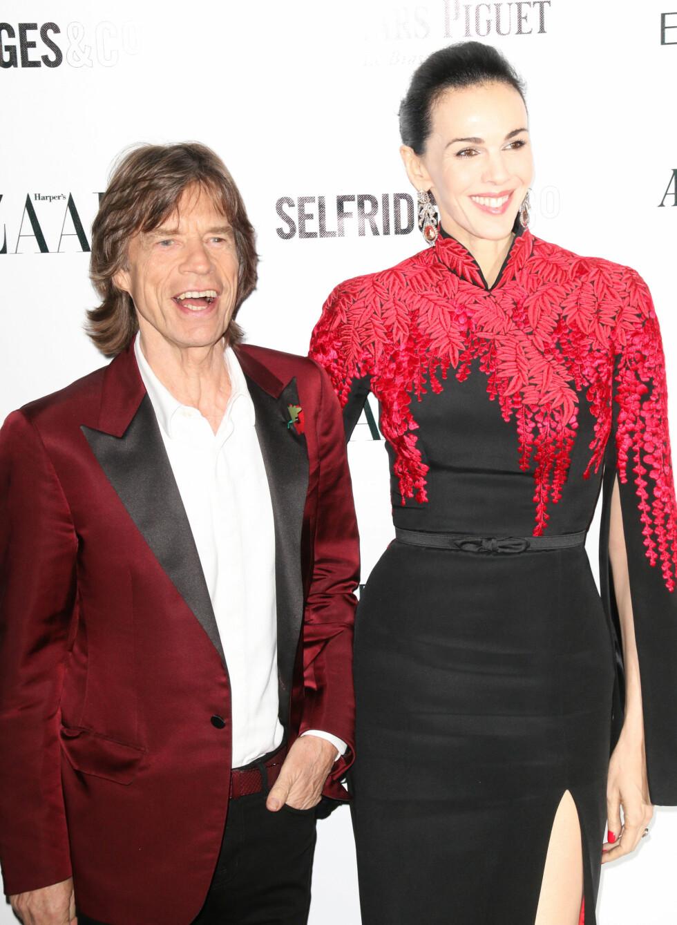 BEGIKK SELVMORD: Mick Jagger var i Australia da han mottok dødsbudskapet. Han og L´Wren Scott hadde da vært sammen i 13 år. Her er paret avbildet på Harper´s Bazaar Women of the Year Awards i november 2013. Foto: Zuma Press