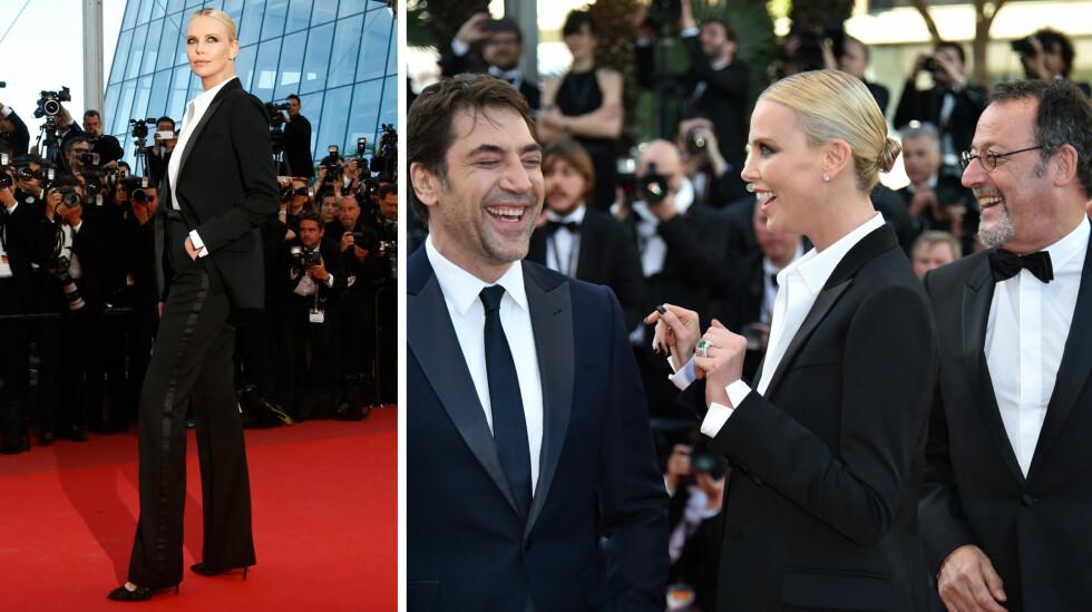 STRÅLTE ALENE: På «The Last Face»-premieren i Cannes fredag kveld, poserte Charlize Theron for fotografene i ensom majestet. Det var også god stemning mellom henne, Javier Bardem og Jean Reno (ytterst t.h) på den røde løperen.  Foto: NTB Scanpix