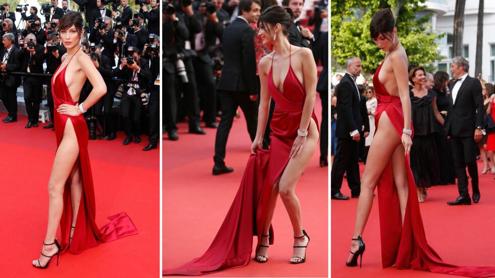 VÅGALT KJOLEVALG: 19 år gamle Bella Hadid var ikke den største stjernen på «The Unknown Girl»-premieren i Cannes tirsdag kveld, men hun var garantert den som vekket mest oppsikt. Den unge toppmodellen var flere ganger faretruende nær en pinlig «kjoleglipp». Foto: NTB Scanpix