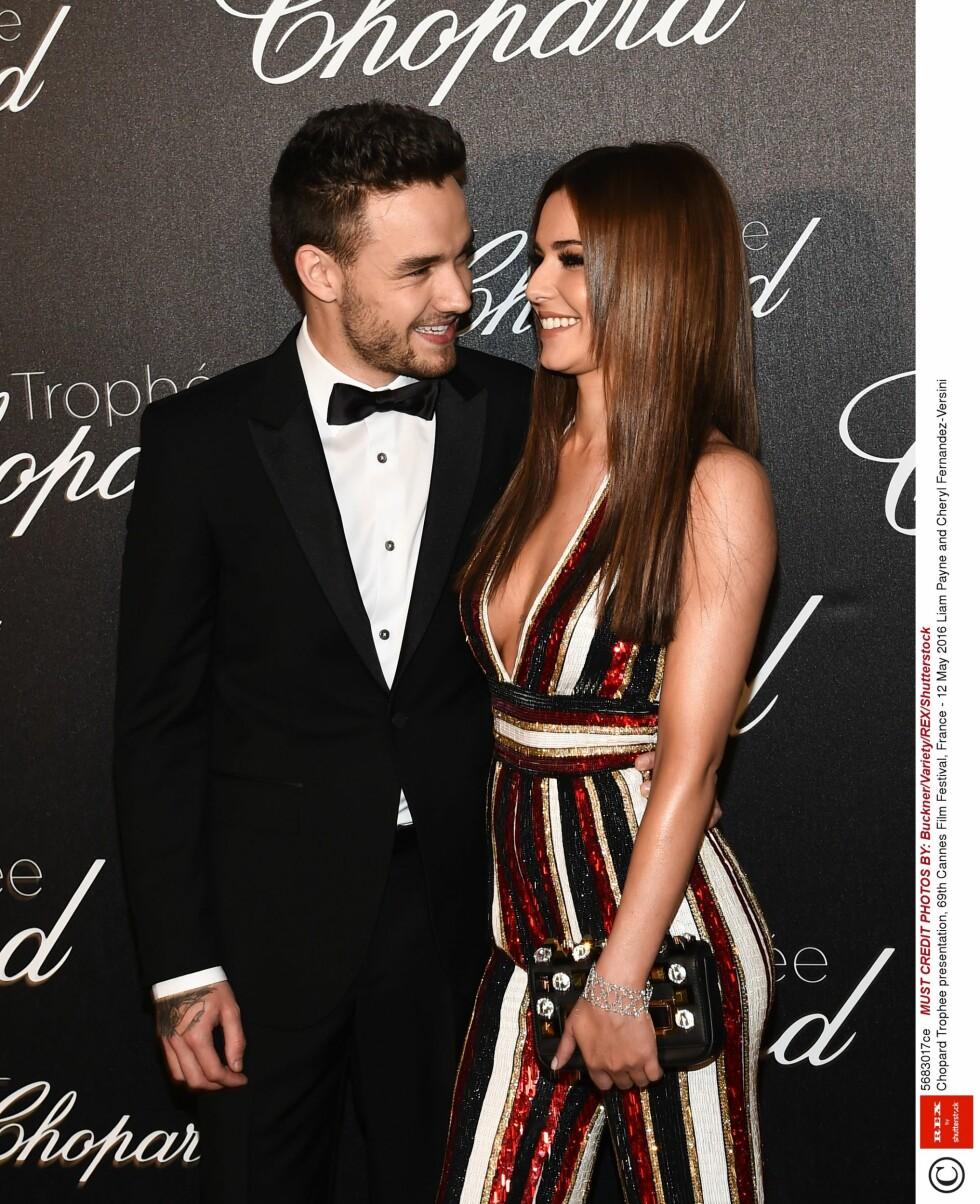 FRISK OG FORELSKET: Cheryl Cole ser ut til å gløde av lykke om dagen. Her er hun og kjæresten Liam Payne på et arrangement i Cannes torsdag 12. mai.  Foto: Rex Features