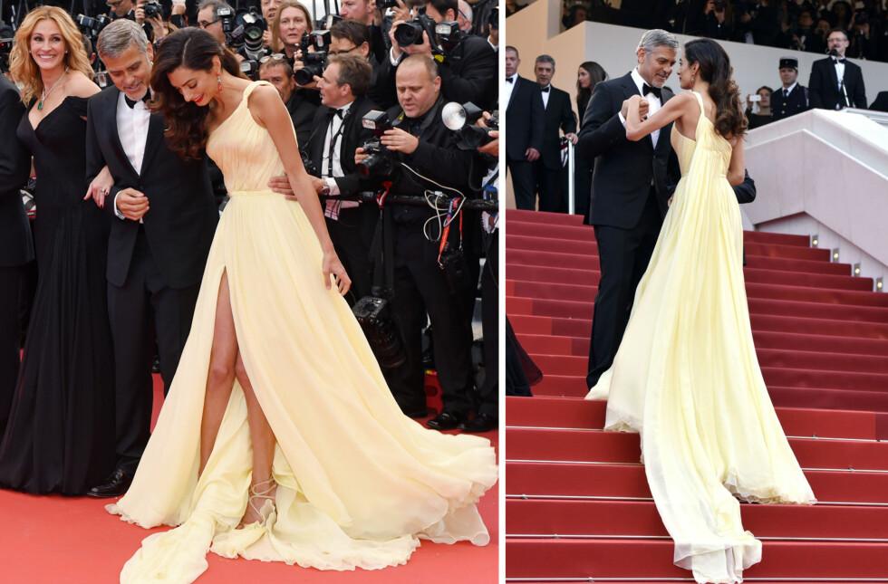 <strong>KREVENDE KJOLE:</strong> Amal Clooney så ut som en drøm på «Money Monster»-premieren i Cannes 12. mai, men slet litt mer på den røde løperen enn Julia Roberts og ektemannen George. Filmstjernen sørget heldigvis for at kona kom seg opp trappene uten knall og fall.  Foto: NTB Scanpix