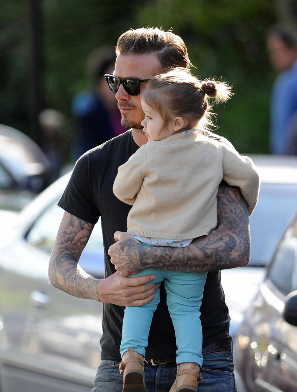 PAPPAKOS: David Beckham med datteren Harper Seven. Hennes navn har pappa beckham fått tatovert like over hjertet sitt.  Foto: Stella Pictures