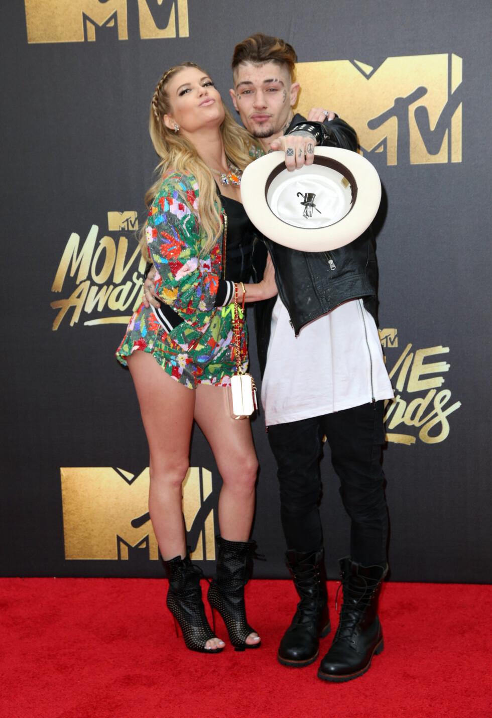 <strong>SLO SEG LØS:</strong> Rapperen Chanel West Coast og sangeren Liam Horne poserte på den røde løperen. Foto: wenn.com