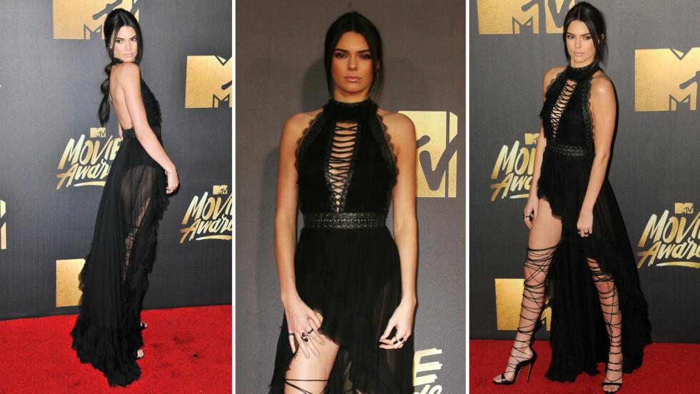 SPESIELLE SKO: Kendall Jenner vakte oppsikt da hun åpnet kjolen og viste frem sine sko som gikk til over kneet på MTV Movie Awards lørdag. Foto: Scanpix