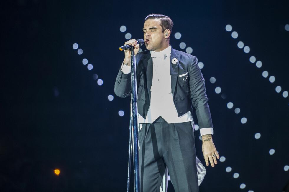 VERDENSBERØMT: Robbie Williams har gjort stor suksess som soloartist etter han forlot boybandet i 1995.  Foto: Splash News