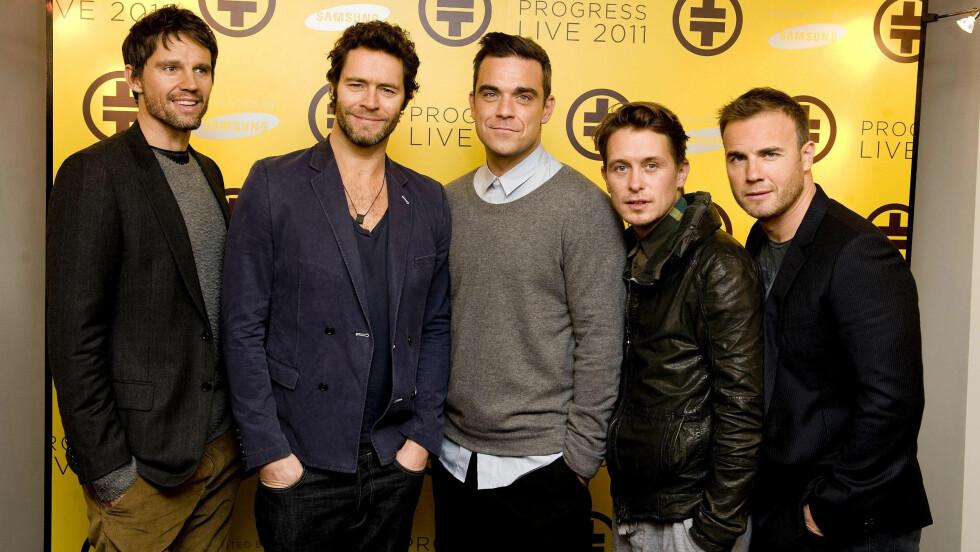 SAMMEN IGJEN: Det populære 90-talls bandet Take That gjenforenes. Det er imidlertid ukjent om Jason Orange (t.v) blir med. Howard Donald, Robbie Williams, Mark Owen og Gary Barlow har bekreftet at de er med.  Foto: Pa Photos