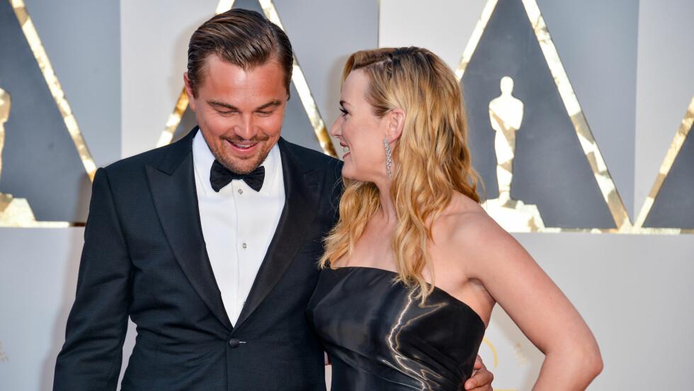 VENNER FOR LIVET: Leonardo DiCaprio lyste opp da han så sin gode venninne Kate Winslet på den røde løperen under Oscar Awards. Foto: SipaUSA