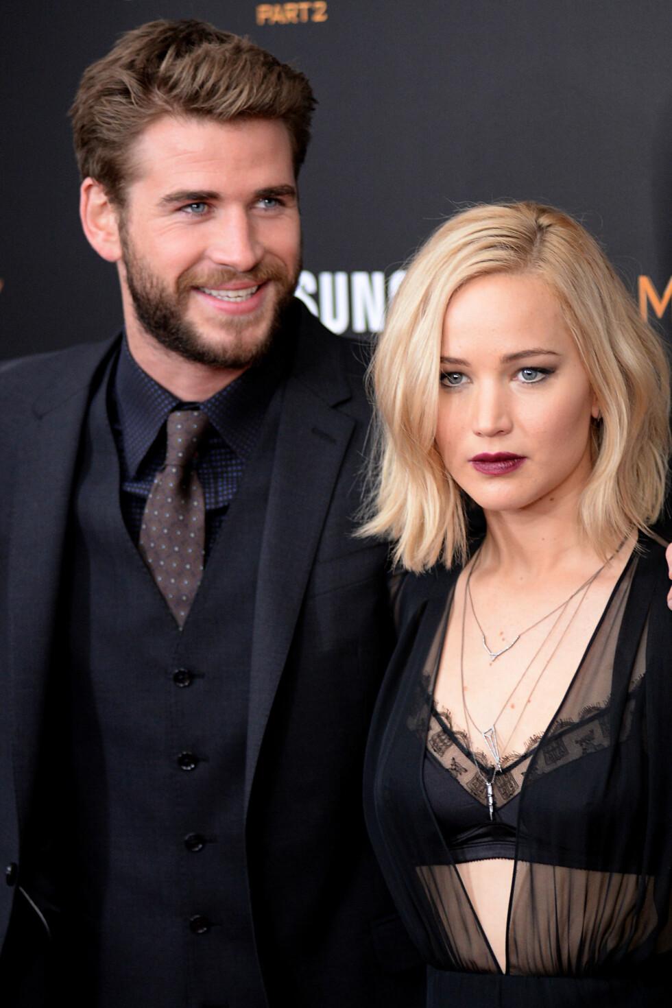 FILMKJEKKAS: Liam Hemsworth og Jennifer Lawrence hadde nylig premiere på sin siste «Hunger Games»-film. Det betyr kanskje at Liam nå har tid til å planlegge bryllup? Her er filmstjernene på «The Hunger Games: Mockingjay- Part 2»-premieren i New York i november. Foto: Zuma Press