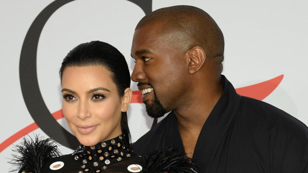 MELLOMNAVN: Kim Kardashian og Kanye West sin nyfødte sønn, skal ha fått navnet Saint Rober West. Foto: Ap