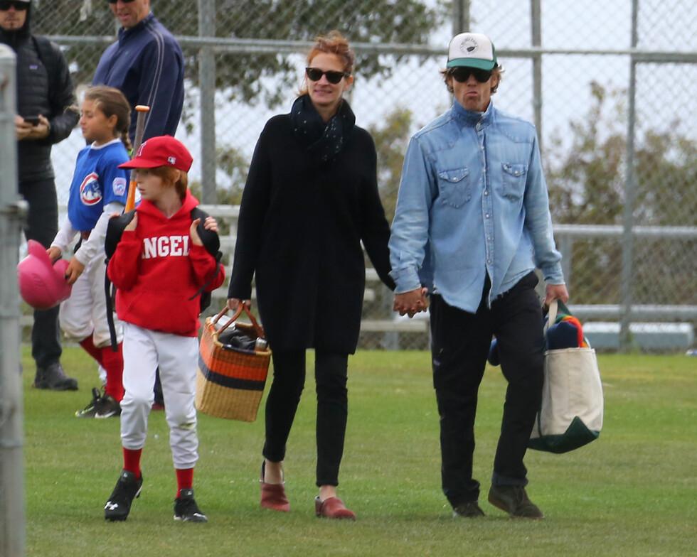 OFTE PÅ KAMP: Paret er ofte til stede for å se sønnen spille. Foto: Splash News
