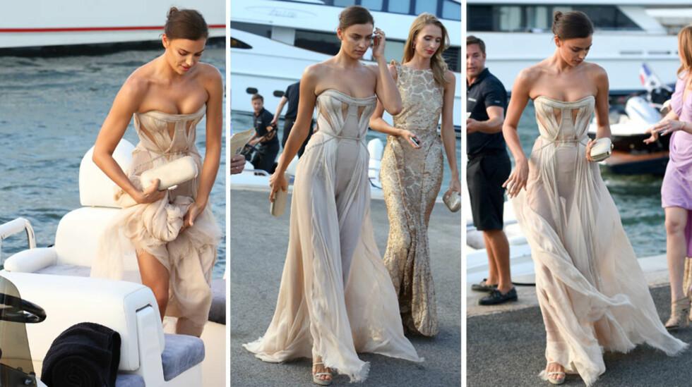 SEXY: Skuespiller og supermodell Irina Shayk steg ut av båten sin i en svært sensuell gallakjole. Skuespiller Bradley Cooper, som skal være hennes nye kjæreste, var ikke å se.  Foto: Splash News