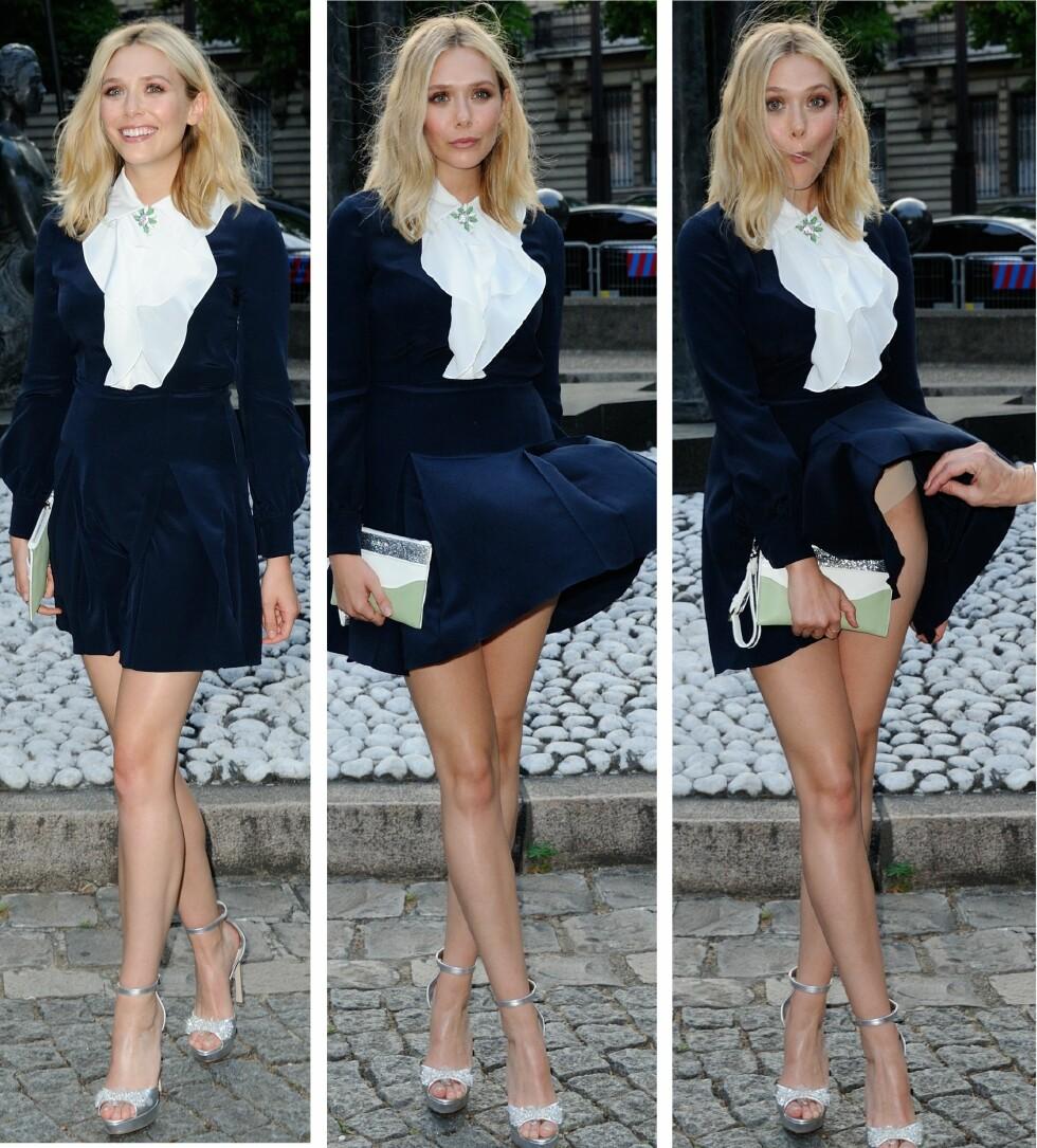 BEGYNTE Å LE: Elizabeth Olsen beholdt fatningen da hun ufrivillig vistre frem litt mer enn planlagt under et moteevent i Paris i helgen. Foto: NTB Scanpix