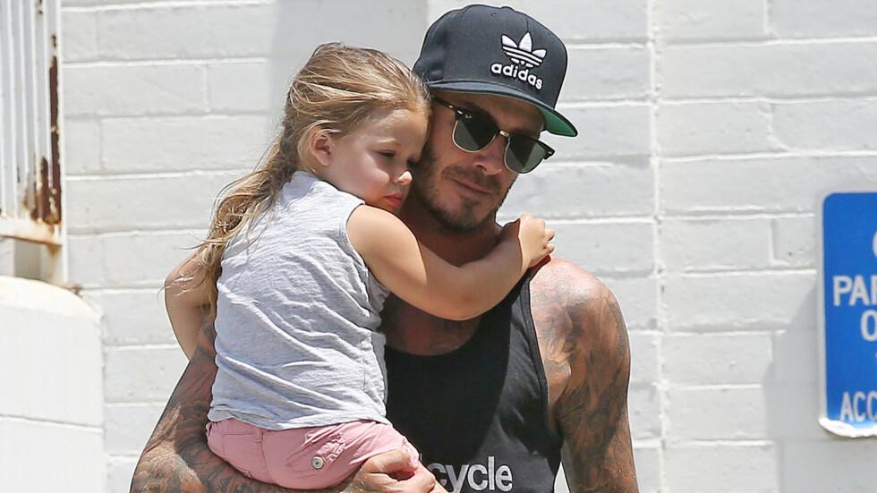 FAR OG DATTER: David Beckham og vesle Harper er en søt liten duo.  Foto: NTB scanpix