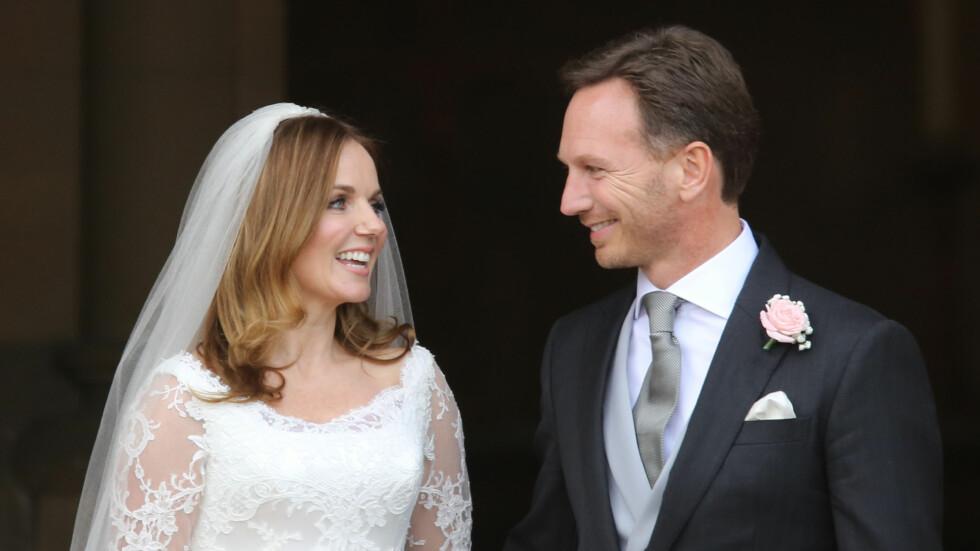 NYGIFTE: Geri Halliwell ser forelsket bort på sin nybakte ektemann Christian Horner etter vielsen.   Foto: Pa Photos