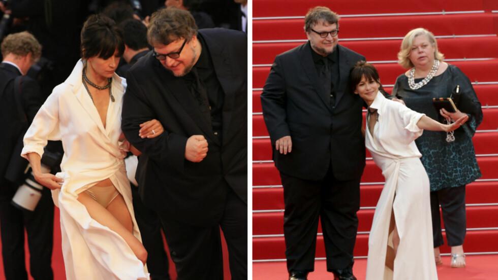 HUFF DA: Den franske filmstjernen Sophie Marceau var iført en kjole som var utfordrende på flere måter, da hun gjestet «Mad Max: Fury Road»-premieren i Cannes torsdag kveld. Omslagskjolens høye splitt, kombinert med et lite slep, gjorde det vanskelig for henne å komme seg tildekket opp trappene.  Foto: Stella Pictures/ NTB Scanpix