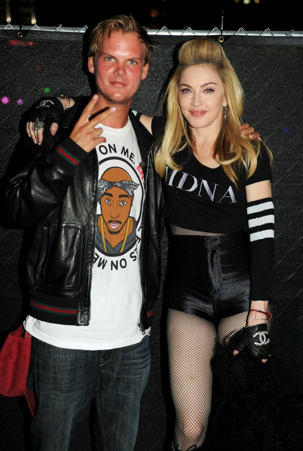 BERØMT: Avicii menger seg med alle de største Hollywood-stjernene. Her sammen med selveste Madonna.  Foto: All Over Press