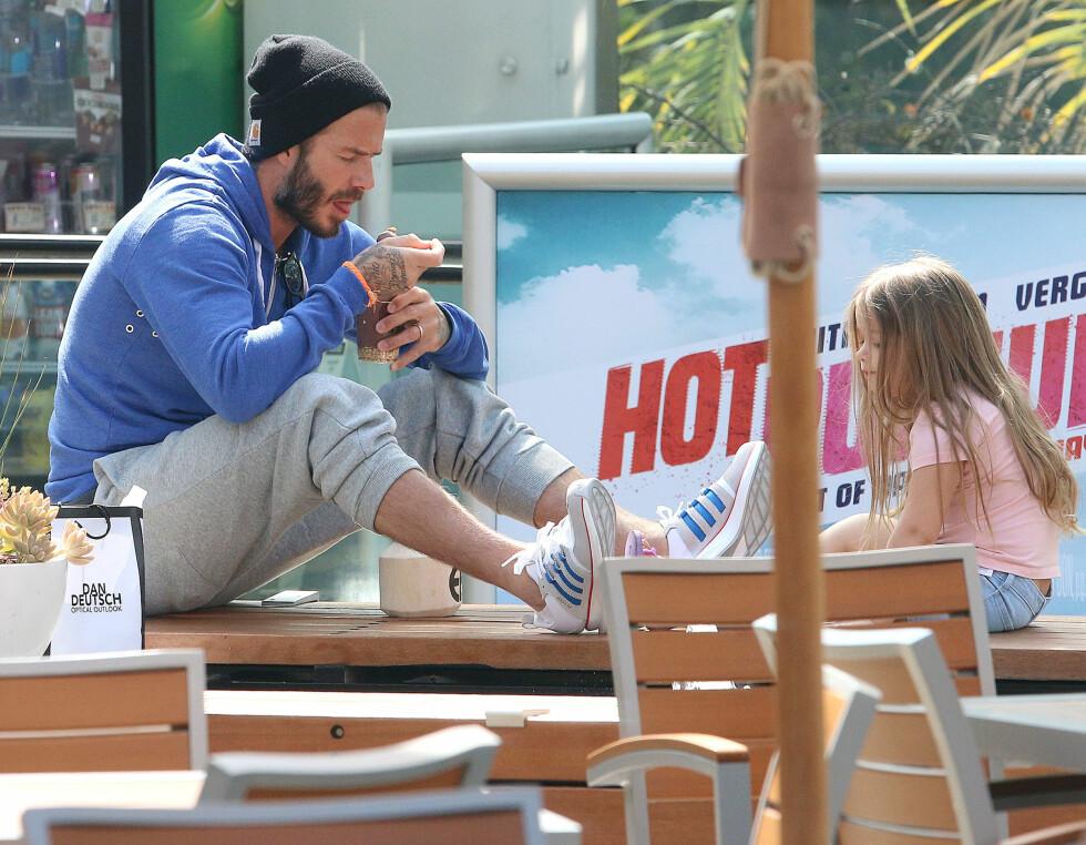 SPESIELT FORHOLD: David Beckham har ikke lagt skjul på at livet har endret seg siden Harper kom inn i livet hans. Foto: Splash News