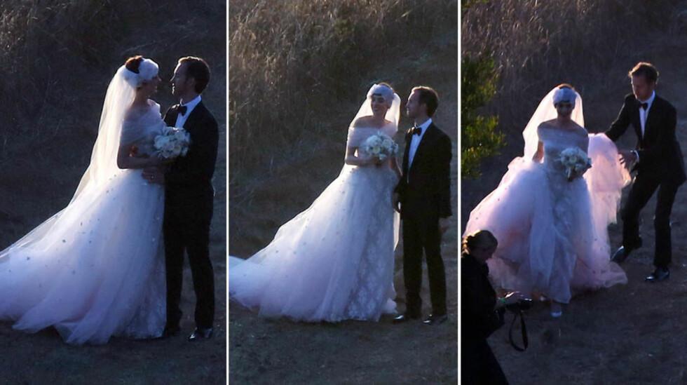 BRYLLUPSIDYLL: Anne Hathaway og Adam Schulman fotografert på bryllupsdagen sin i 2012, mens de poserte for bryllupsfotografen i Big Surs omgivelser.  Foto: All Over Press