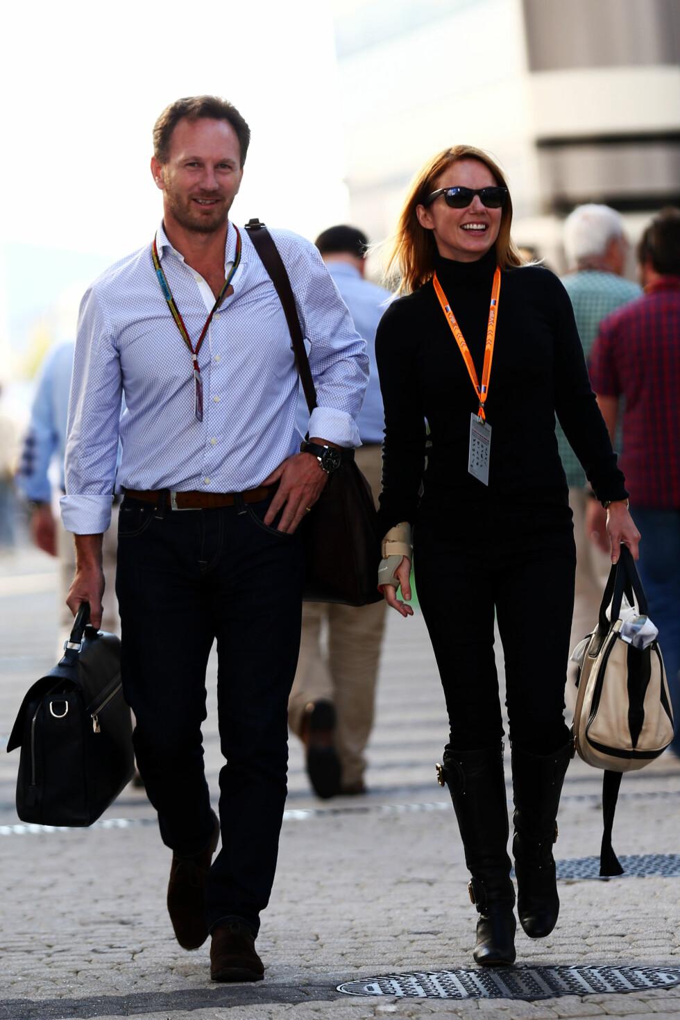 VED MANNENS SIDE: Geri Halliwell og Christian Horner er som erteris. For en måned siden var sangstjernen med kjæresten til Sotsji, i anledning russiske Formel 1 Grand Prix. Foto: Action Press/All Over Press