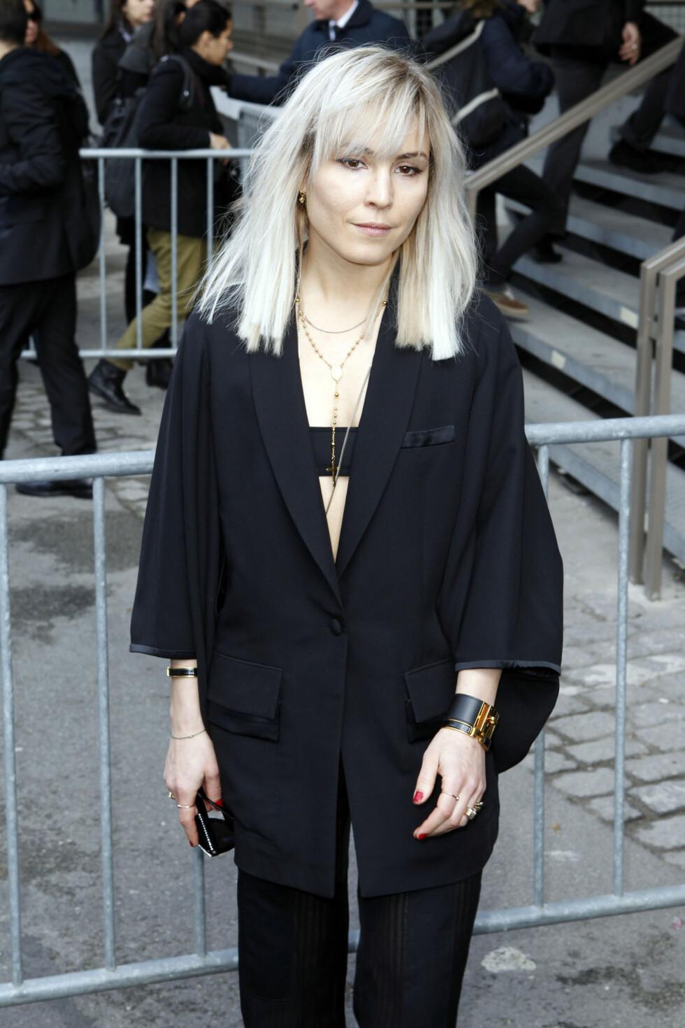 ASIATISK: Da Noomi ankom Givenchys herremoteshow i Paris i januar 2014, var «looken» hennes minimalistisk og asiatiskinspirert. Foto: FameFlynet