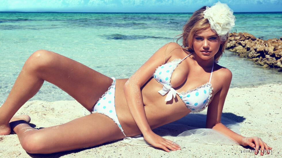 VIL IKKE VISE SEG NAKEN: Kate Upton sier sosiale medier har skremt henne fra å takke ja til å posere uten en tråd. Her er hun i en reklame for badedraktmerket Beach Bunny. Foto: Stella Pictures