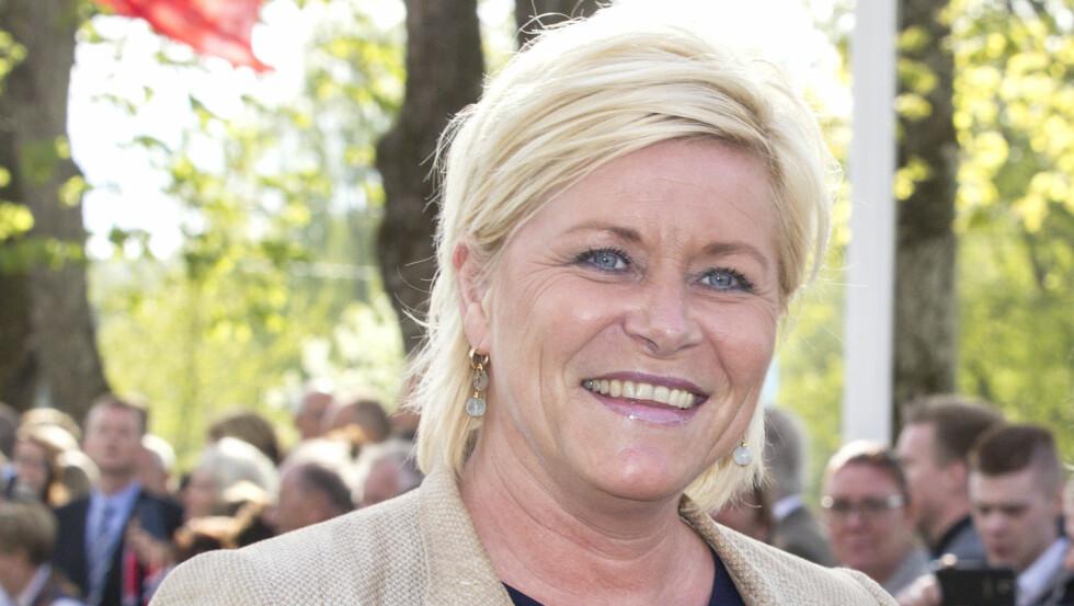 GIKK OPP I VEKT ETTER AT HUN BLE MINISTER: Siv Jensen sier til P4 at hun ble finansminister. Her hun fotografert under markeringen av Grunnlovsjubileet på Eidsvoll 17. mai. Foto: Andreas Fadum