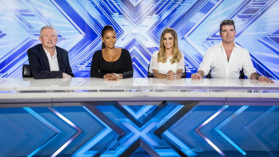 <strong>NÅ ER HUN TILBAKE:</strong> Mandag startet Cheryl Cole innspillingen av britiske «X Factor» sammen med Simon Cowell som ga henne sparken fra samme jobben i 2011. Manager Louis Walsh og Spice Girls-stjerne Melanie Brown er også med i dommerpanelet.  Foto: Corbis / Thames / Syco/ All Over Press