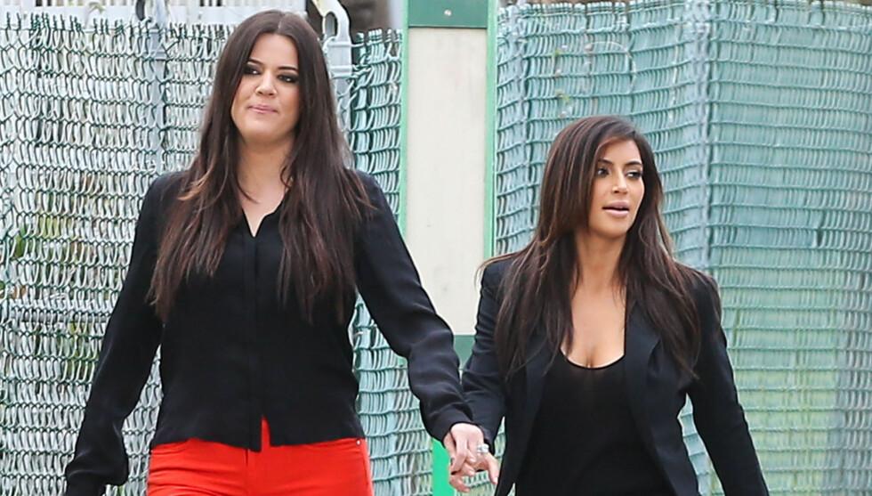MISUNNELIG: Khloé Kardashian har et godt forhold til søsteren Kim, men skal ha blitt knust da det ble kjent at hun er gravid.  Foto: FameFlynet