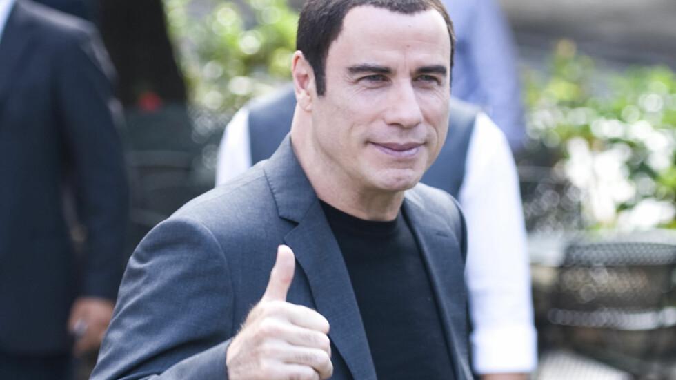 FORNØYD: John Travolta har hatt noen vanskelige måneder med stadig flere søksmål og anklager om seksuell trakassering. Torsdag fikk han en seier i retten da et av søksmålene ble avvist av dommeren.  Foto: All Over Press