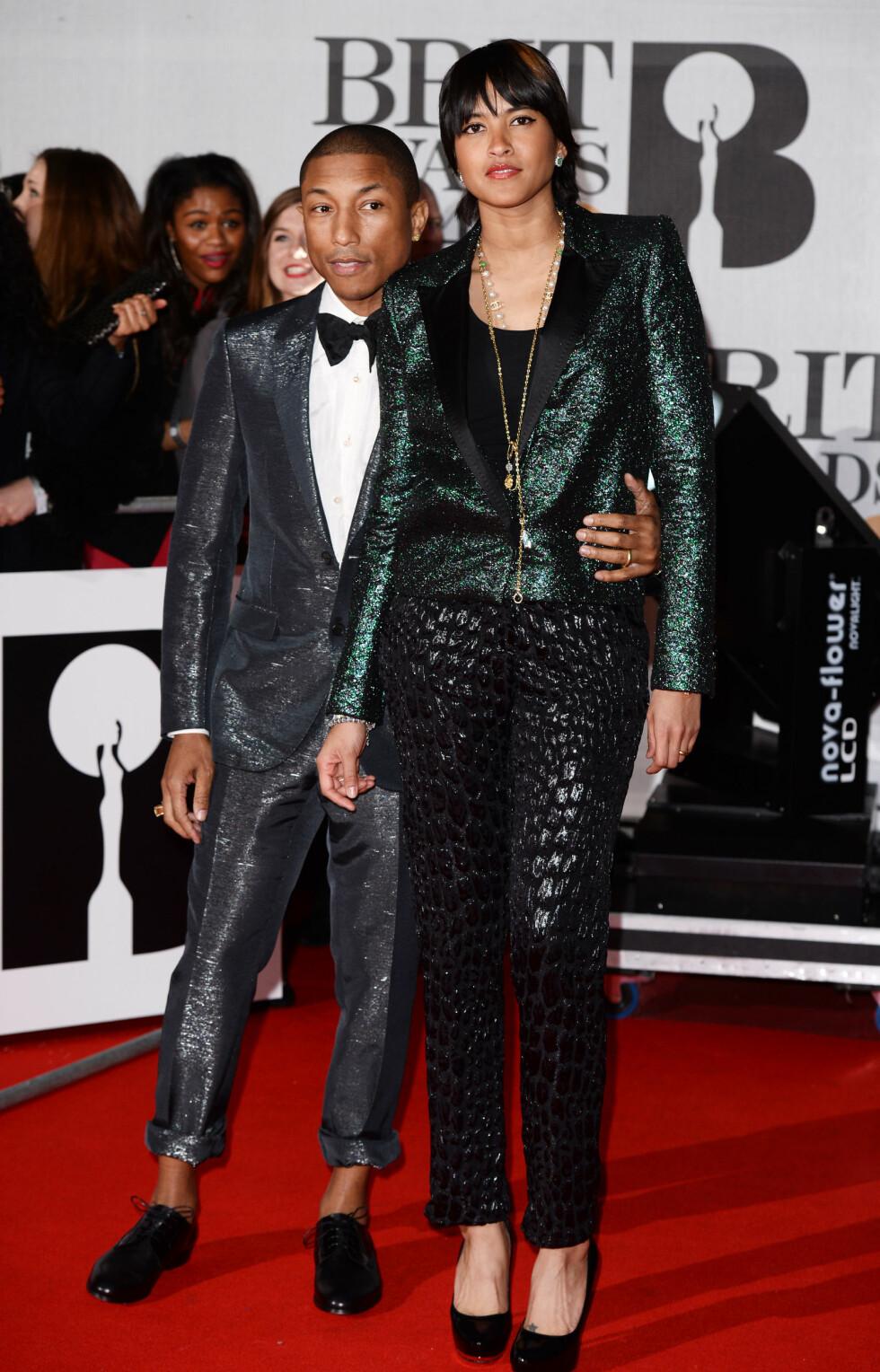 Rapperen Pharrell Williams (40) og kona Helen Lasichanh. Foto: REX/David Fisher/All Over Press