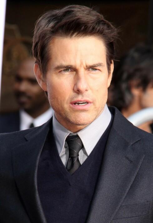 HINDRES: Pappagruppen mener Holmes hindrer Tom Cruise i å få se datteren Suri. Foto: REX/Unimedia Images/All Over Press