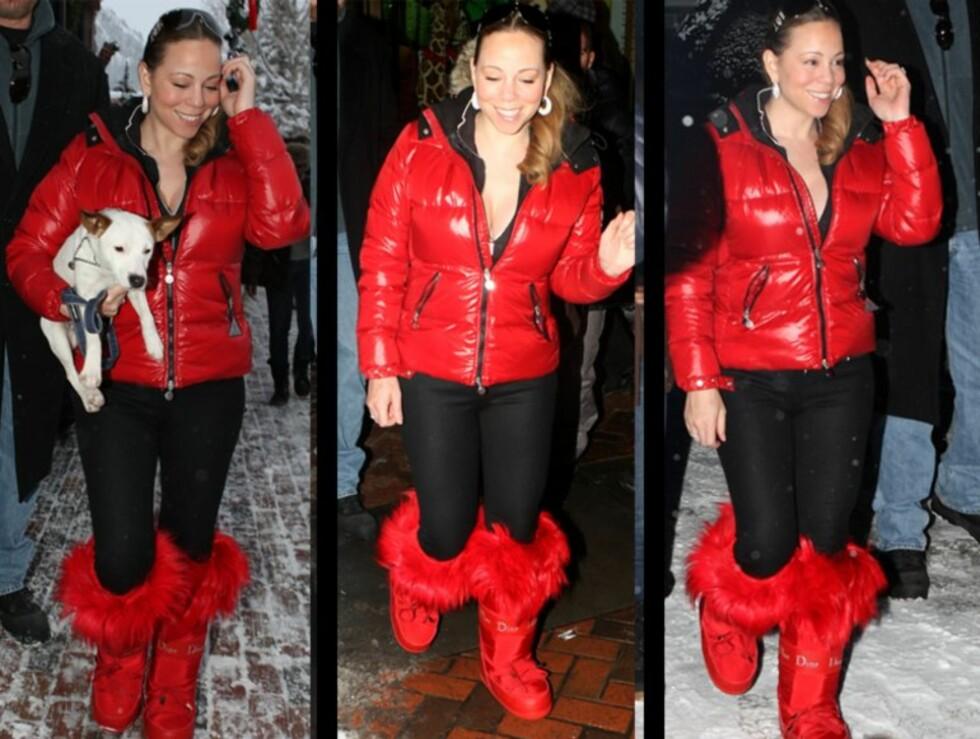 <strong>JULENISSE?:</strong> Mariah så nærmest ut som et sukkertøy der hun vandret rundt i Aspen i knallrød boblejakke og matchende moon boots fra Christian Dior.