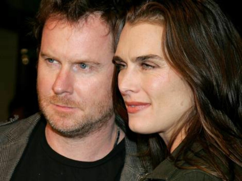 "HOLLYWOOD - OCTOBER 23:  Actress Brooke Shields (R) and husband Chris Henchy arrive at the premiere of ""Borat: Cultural Learnings Of America"" held at the Grauman's Chinese Theatre on October 23, 2006 in Hollywood, California.  (Photo by David Livingston/G Foto: All Over Press"