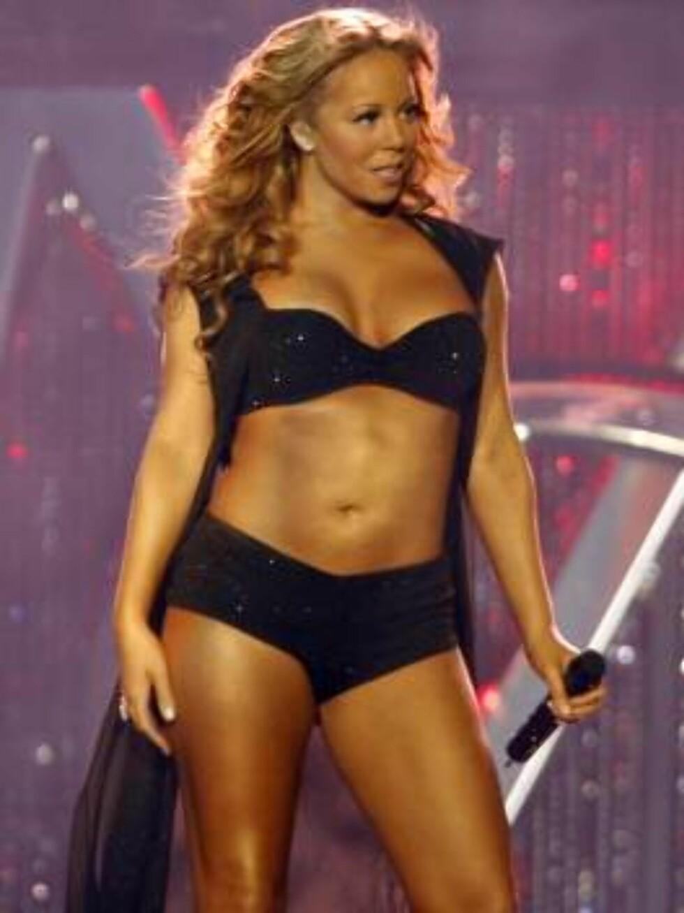 "Singer Mariah Carey performs during her ""Emancipation of Mimi"" concert in Los Angeles on Friday, Oct. 6, 2006. (AP Photo/Matt Sayles) Foto: AP"