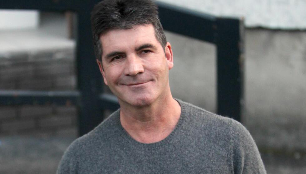 BLIR PAPPA: Simon Cowell venter barn med kameratens kone.  Foto: All Over Press