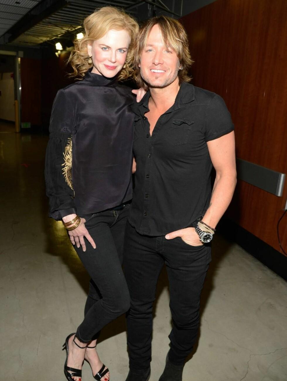 EKSTEPAR: Musikkglade Nicole Kidman og Keith Urban fikk med seg Rolling Stones-konserten fredag kveld. Foto: All Over Press