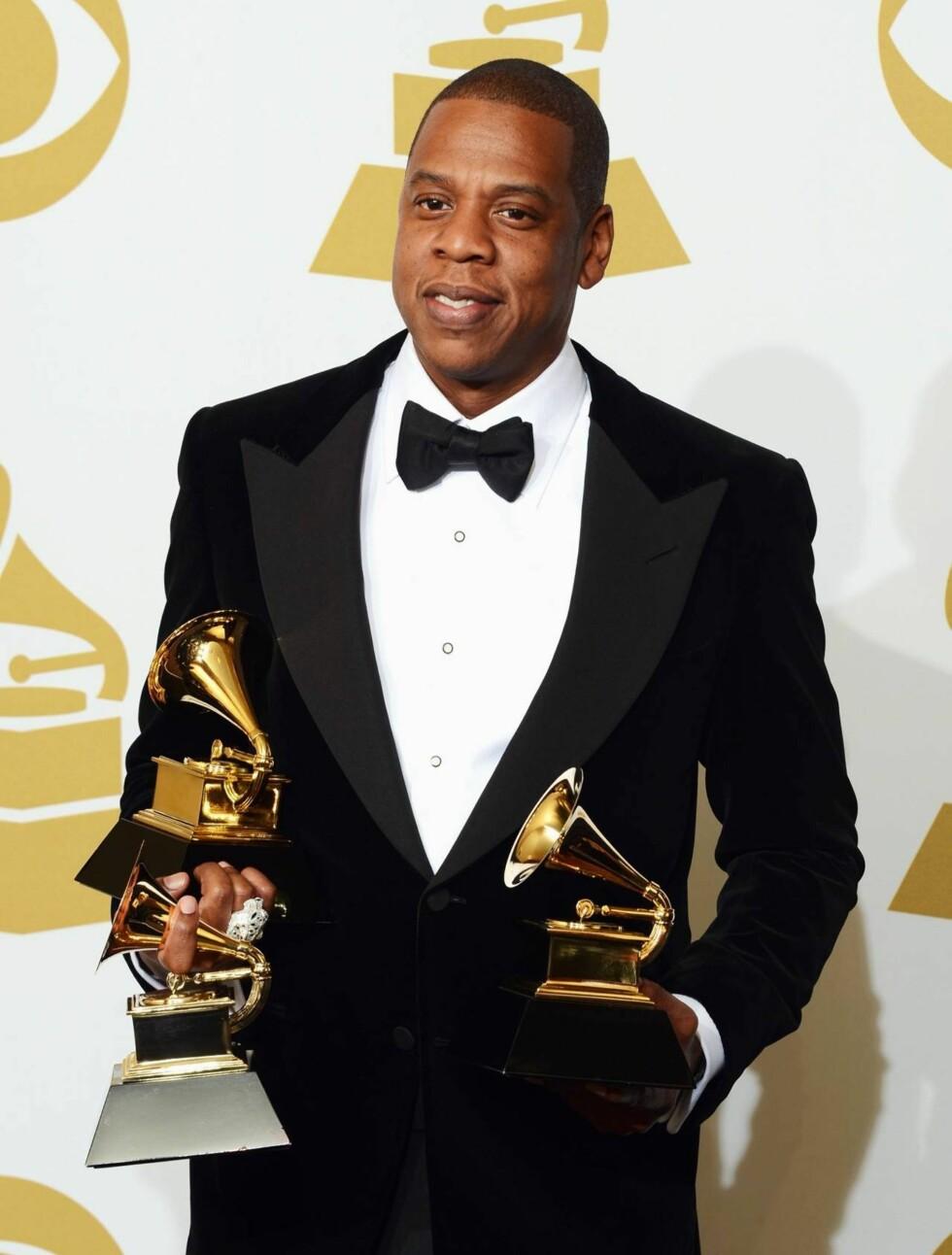 PRISER: Jay-Z og Kanye West innkasserte hele tre priser under søndagens Grammy-utdeling - men hip hop-kongen måtte hente prisene alene, ettersom Kanye var i Rio. Foto: All Over Press