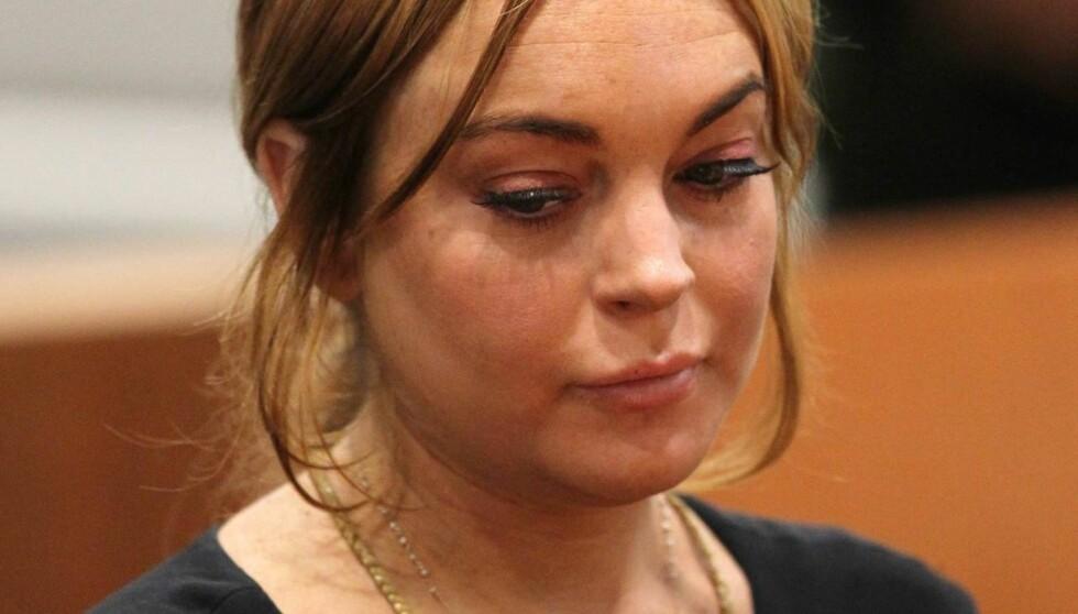 SØVNIG: Lindsay Lohan så trøtt ut under rettssaken onsdag formiddag. Foto: All Over Press