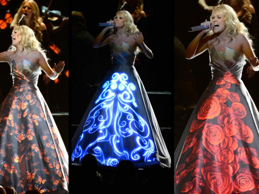 LYSSHOW: Publikum gispet da Carrie Underwoods skiftet farge og mønstre under hennes Grammy-opptreden. Foto: All Over