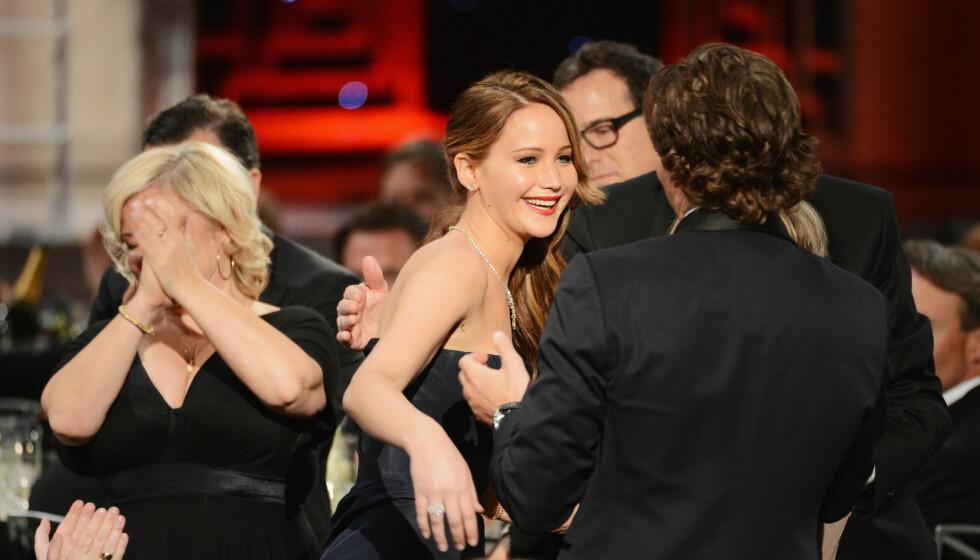 BLE HEDRET: Jennifer Lawrence vant prisen for beste kvinnelige skuespiller i filmen «Silver Linings Playbook» hvor hun spiller mot kjekkasen Bradley Cooper.  Foto: All Over Press