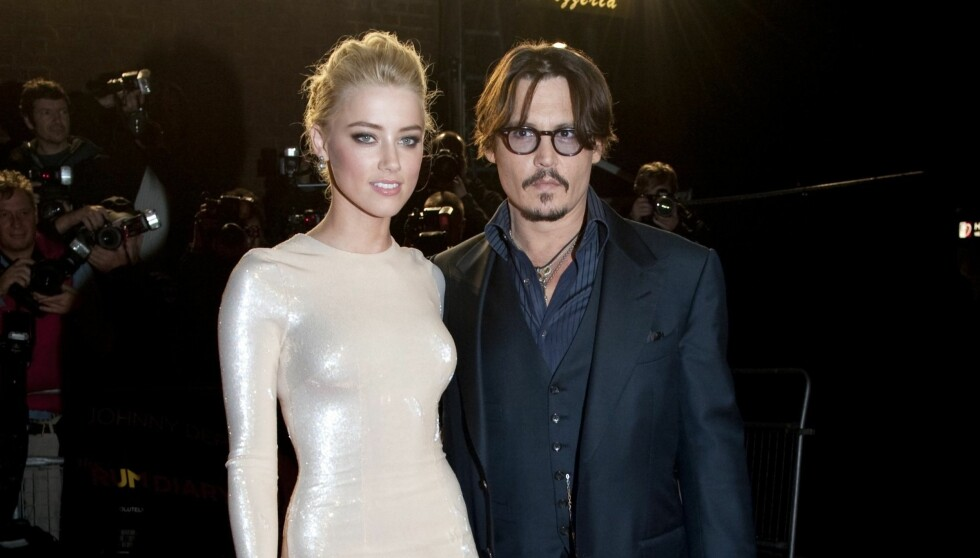 JOBBFLØRTEN BLE FOR MYE: Kort tid før det ble bekreftet at Johnny Depp og Amber Heard innledet et hett forhold under innspillingen av «The Rum Diary». Nå er det slutt. Her er de sammen på premieren i London. Foto: All Over Press