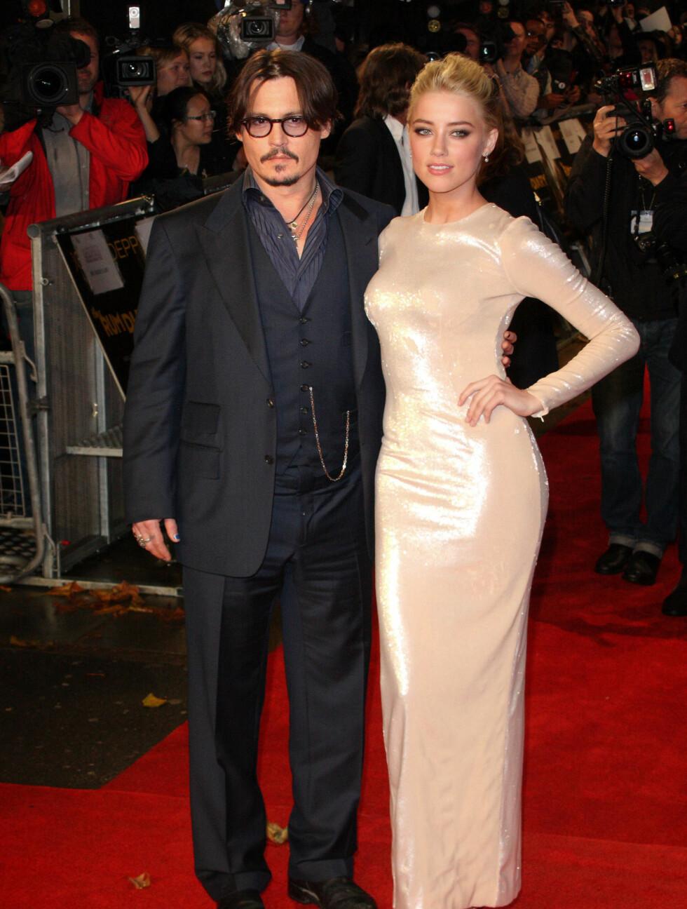 SKANDALEPAR: Johnny Depp forlot sin kjæreste gjennom 14 år, Vanessa Paradis, for skuespillerkollegaen Amber Heard. Nå skal de to ha kjøpt et hus sammen. Kanskje blir det også en juleforlovelse? Foto: Stella Pictures